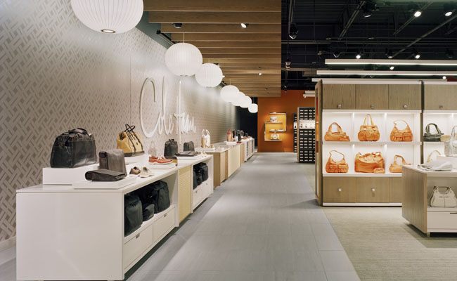 "ff65474f19 ... house"" concept that the first-quality stores evoke. Patrons are drawn  in by the glowing paper pendants, illuminated identity-orange storefront  display ..."