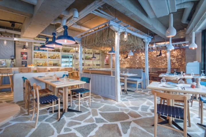 Kuzina traditional greek restaurant in Bucharest by Corvin Cristian & Serban Rosca