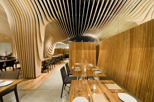 Banq Restaurant - wood slatted ceiling design by Nadaaa